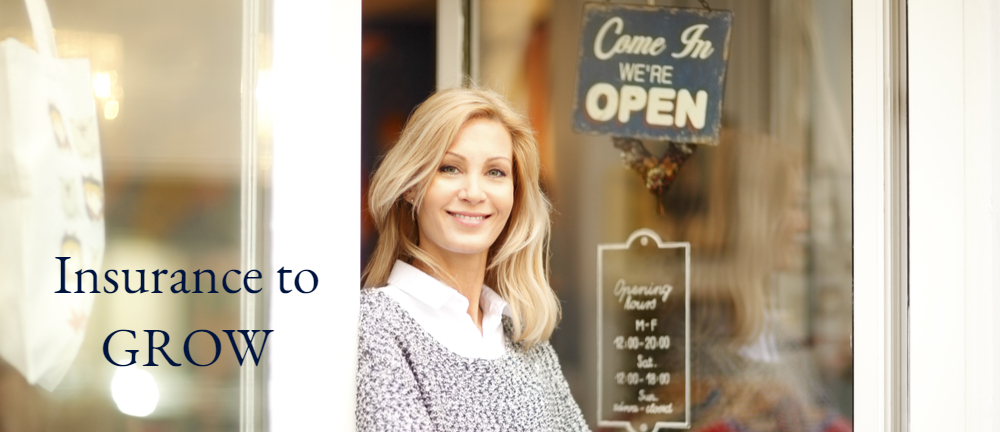 Woman standing in the doorway of her small business