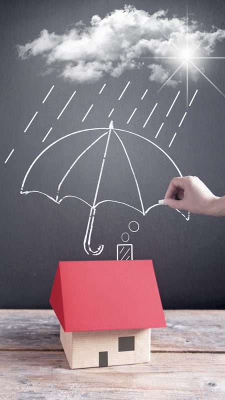 Cloud raining on an umbrella covering a house